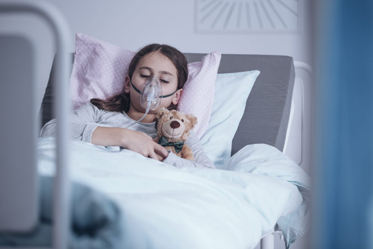 sick-girl-with-oxygen-mask-sleeping-in-a-hospital-SMDHKJG-min-1200x800.jpg